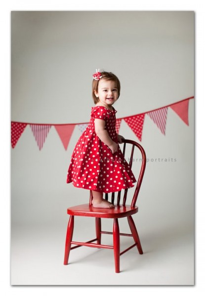 red and white bunting banner hanging in background dots stripes